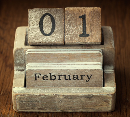 february: A very old wooden vintage calendar showing the date 1st February on wood background Stock Photo