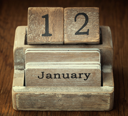 12 month old: A very old wooden vintage calendar showing the date 12th January on wood background