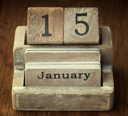 fifteen year old: A very old wooden vintage calendar showing the date 15th January on wood background