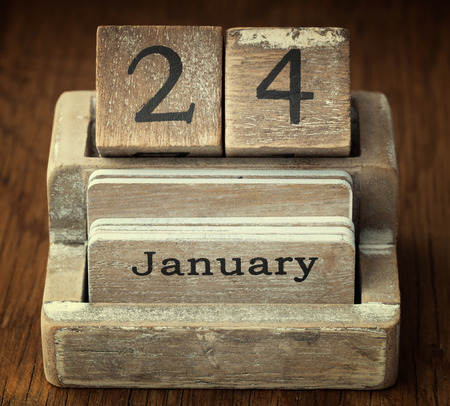 24 month old: A very old wooden vintage calendar showing the date 24th January on wood background