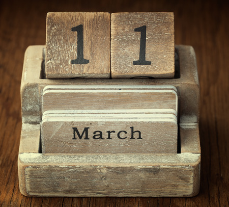 11 year old: A very old wooden vintage calendar showing the date 11th March on wood background Stock Photo