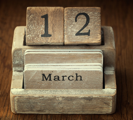 twelve month old: A very old wooden vintage calendar showing the date 12th March on wood background