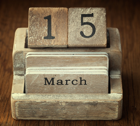 fifteen year old: A very old wooden vintage calendar showing the date 15th March on wood background Stock Photo