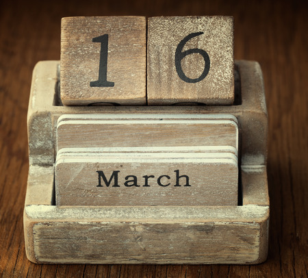 sixteen year old: A very old wooden vintage calendar showing the date 16th March on wood background