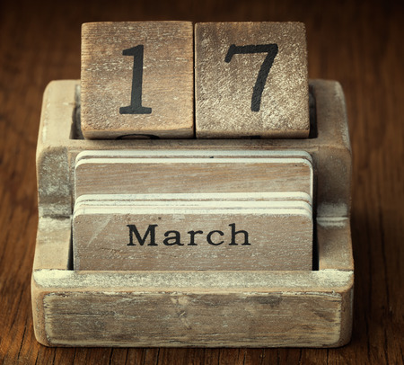 17th of march: A very old wooden vintage calendar showing the date 17th March on wood background Stock Photo