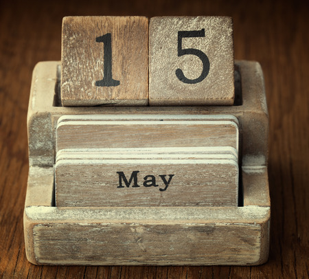 fifteen year old: A very old wooden vintage calendar showing the date 15th May on wood background