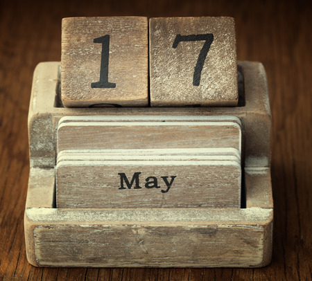 seventieth: A very old wooden vintage calendar showing the date 17th May on wood background