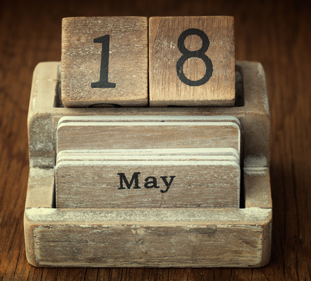 18 year old: A very old wooden vintage calendar showing the date 18th May on wood background