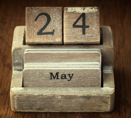 24 month old: A very old wooden vintage calendar showing the date 24th May on wood background