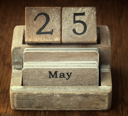 25 years old: A very old wooden vintage calendar showing the date 25th May on wood background
