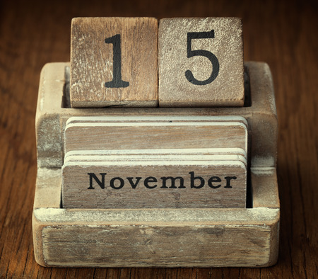 fifteen year old: A very old wooden vintage calendar showing the date of 15th November on wood background Stock Photo