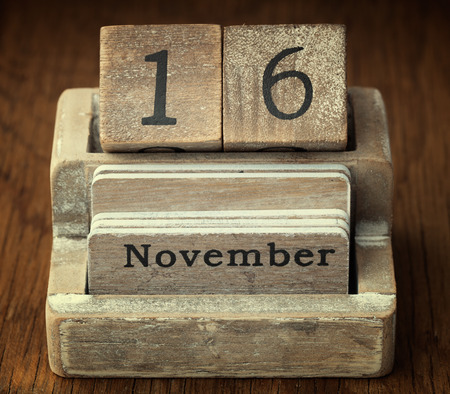 sixteen year old: A very old wooden vintage calendar showing the date of 16th November on wood background
