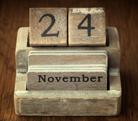 24 month old: A very old wooden vintage calendar showing the date of 24th November on wood background