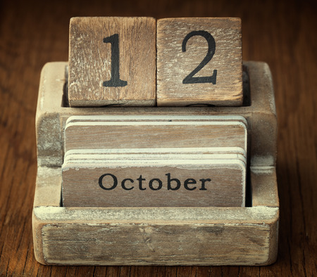 twelve month old: A very old wooden vintage calendar showing the date of 12th October on wood background
