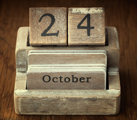 24 month old: A very old wooden vintage calendar showing the date of 24th October on wood background