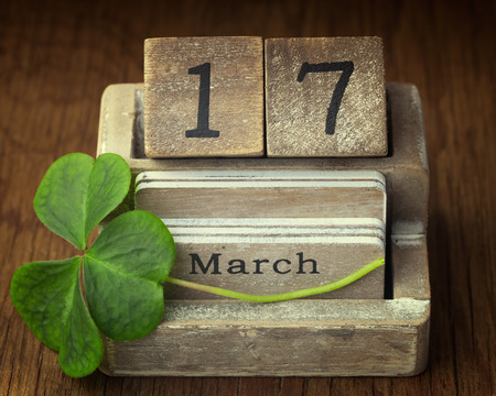 march 17: Old vintage calender showing the date 17th of march which is St.Patricks day with lucky shamrock