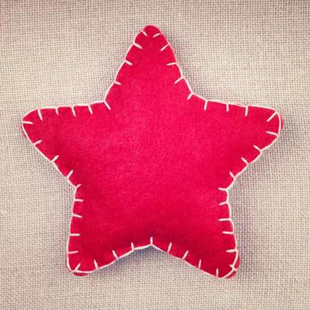 fabric surface: Handmade  red star on a fabric surface