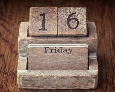 sixteen year old: Grunge calendar showing Friday the sixteenth on wood background