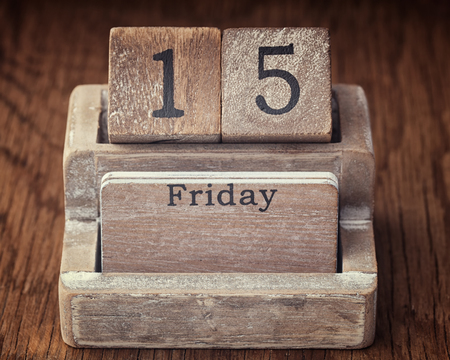 fifteen year old: Grunge calendar showing Friday the fifteenth on wood background Stock Photo