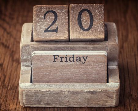 twentieth: Grunge calendar showing Friday the twentieth on wood background