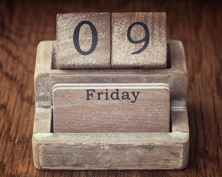 ninth: Grunge calendar showing Friday the ninth on wood background Stock Photo