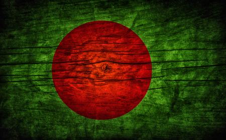 national flag bangladesh: The national vintage flag of Bangladesh on wooden surface