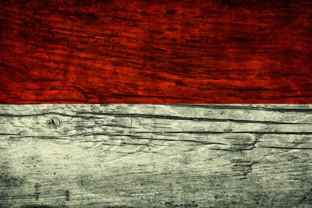 The national vintage flag of Indonesia  on wooden surface Standard-Bild