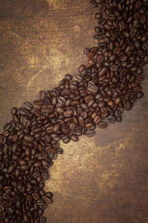 coffeebeans: Dark roasted coffee beans on vintage grunge surface
