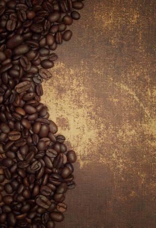 coffeebeans: Dark roasted coffee beans on the side of a shabby chic surface