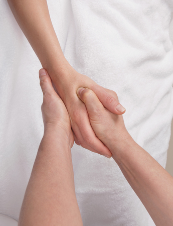 therapeutic: Qualified therapist doing therapeutic palm massage