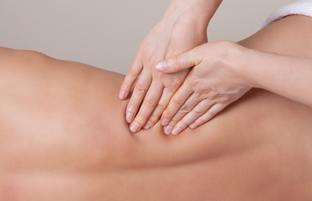 connective: Professional  therapist working on the lower back muscle