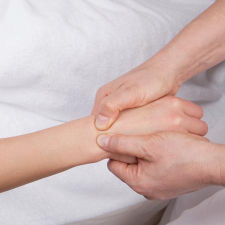 Qualified therapist doing deep tissue wrist massage