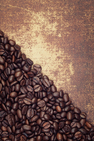 faux: Dark roasted coffee beans on a faux leather material background