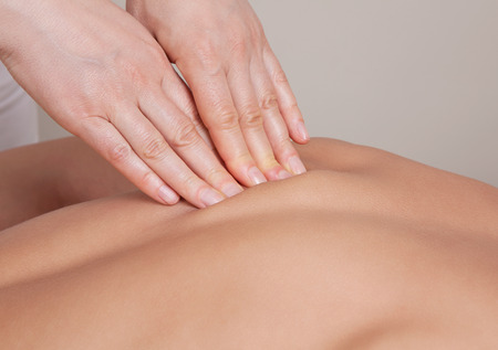 Close up of connective tissue massage on  a muscle group  of a womans back Stock Photo