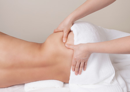 women hips: Qualified therapist  doing pressure point massage on a womans hip