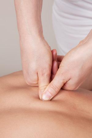 connective: Deep connective tissue massage on a womans shoulder blade