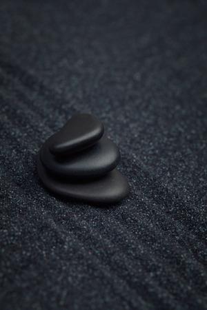 raked: Black pebbles on a raked sand
