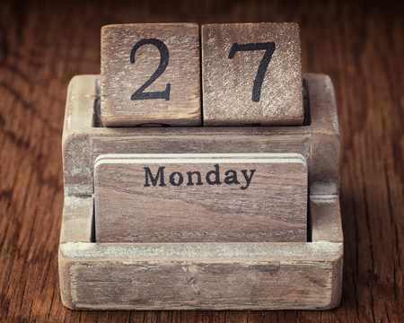 27 years old: Grunge calendar showing Monday the twenty seventh on wood background Stock Photo