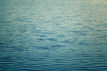 distinctive: A rippled body of water with a distinctive deep blue color