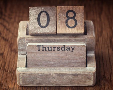 thursday: Grunge calendar showing Thursday the eighth on wood background Stock Photo