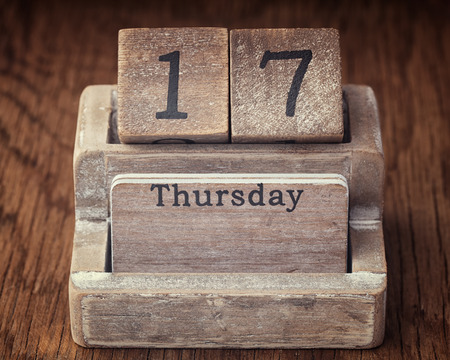 17 year old: Grunge calendar showing Thursday the seventieth on wood background