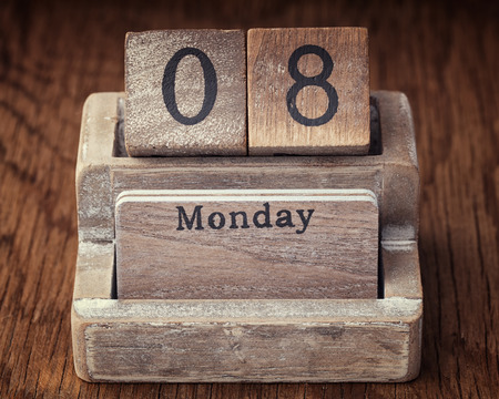 eighth: Grunge calendar showing Monday the eighth on wood background
