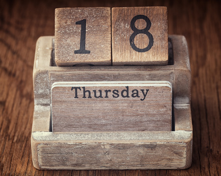 eighteenth: Grunge calendar showing Thursday the eighteenth on wood background