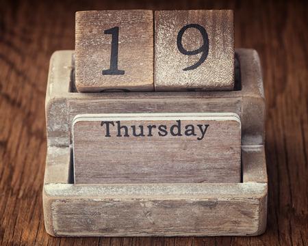19 year old: Grunge calendar showing Thursday the nineteenth on wood background Stock Photo