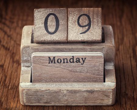 ninth: Grunge calendar showing Monday the ninth on wood background
