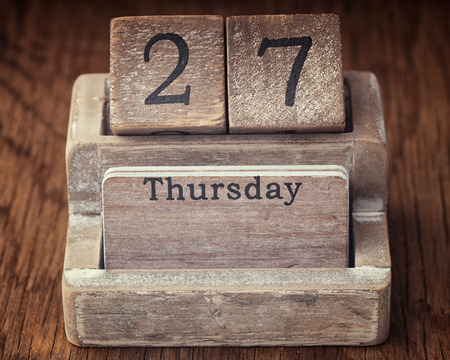27 years old: Grunge calendar showing Thursday the twenty seventh on wood background