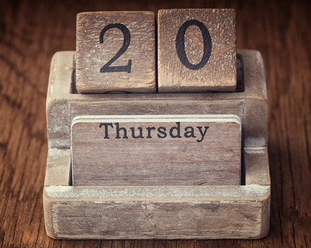 thursday: Grunge calendar showing Thursday the twentieth on wood background