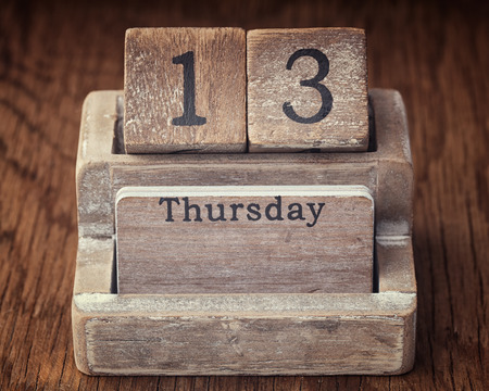 the thursday: Grunge calendar showing Thursday the thirteenth on wood background