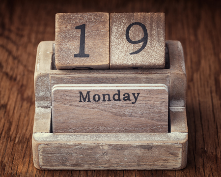 19 years old: Grunge calendar showing Monday the  nineteenth on wood background