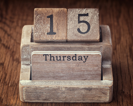 fifteen year old: Grunge calendar showing Thursday the fifteenth on wood background Stock Photo